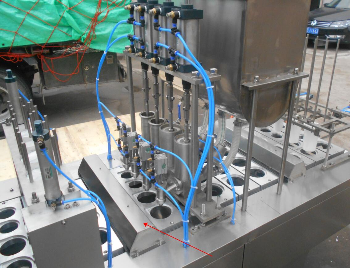 four cup filling machine.jpg